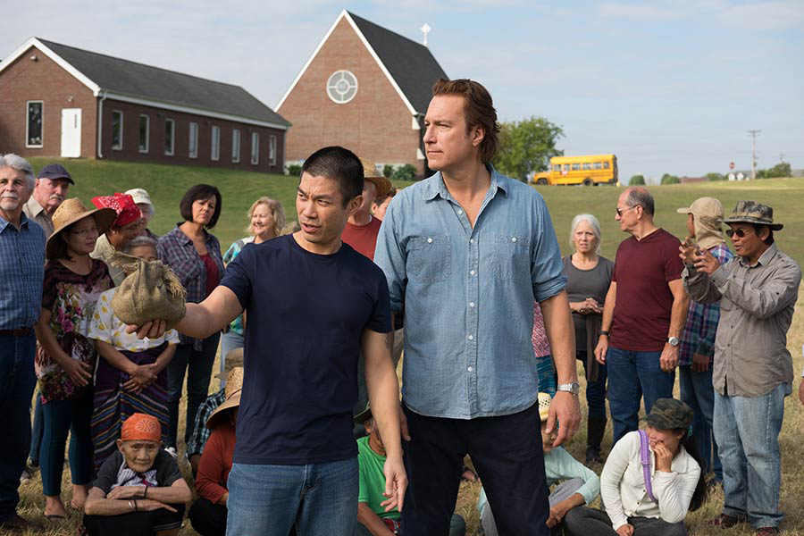 """Ye Win (played by Nelson Lee) and the Rev. Michael Spurlock (played by John Corbett) talk about the work of All Saints' Episcopal Church in the new movie """"All Saints."""" Photo courtesy of Sony."""