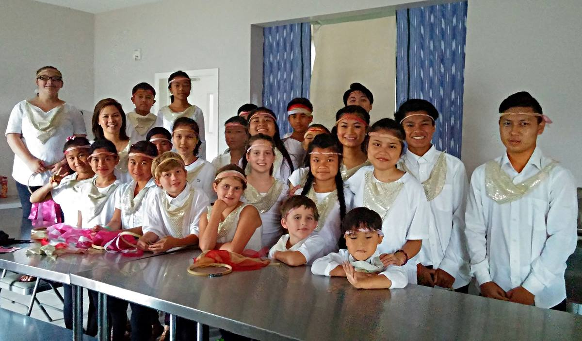 Youth wear traditional Karen outfits for a new year's celebration at Rhems United Methodist Church. Church members prayed for children, and they believe God answered those prayers. Photo courtesy of Rhems United Methodist Church