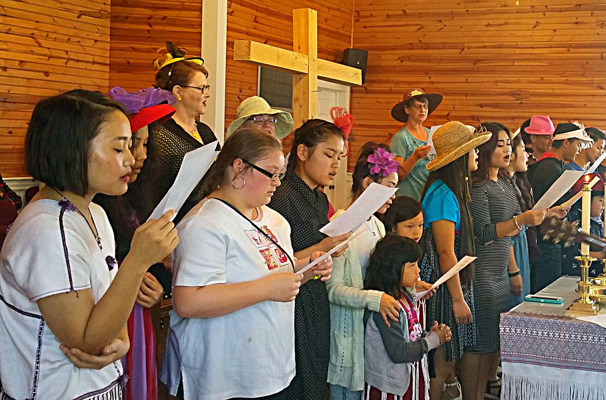 The choir of Rhems United Methodist Church in New Bern, N.C., sings an anthem on Palm Sunday. The rural church has seen its ministry grow with the addition of Karen refugees from Burma. Photo courtesy of Rhems United Methodist Church.