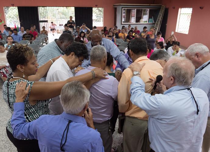 United Methodist bishops from the U.S. pray with pastors at Fuente de Luz United Methodist Church, Danlí, Honduras.