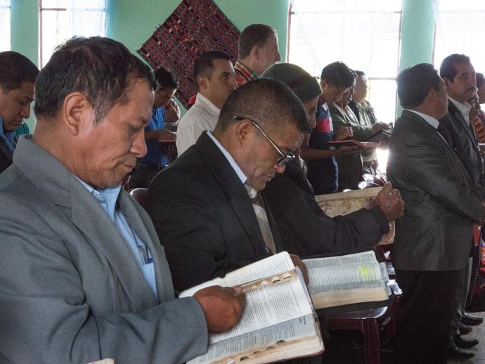 Pastors from Patuluc 1 and members of Iglesia Nacional Methodista Fuente De Vida, Guatemala, participate in worship service on July 24.