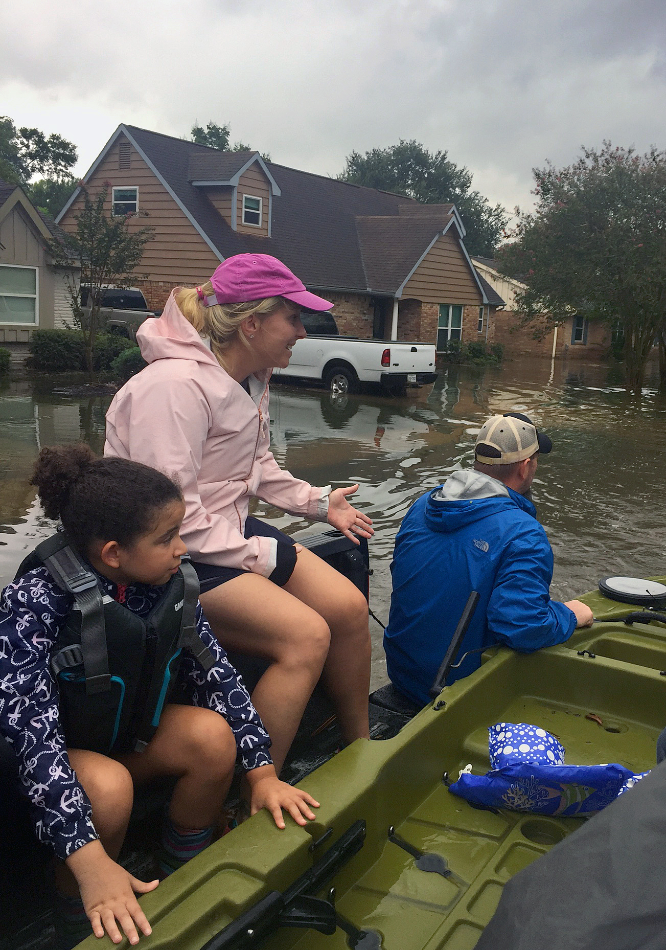 A team from Christ United Methodist Church, in Sugar Land, Texas, evacuated by boat the family of the Rev. R. DeAndre Johnson, a member of the church staff. Johnson said his home had taken on close to a foot of water on Aug. 27, when he made the decision to evacuate. Photo courtesy the Rev. Chappell Tempell.