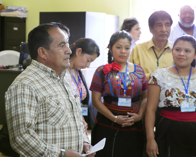 The Rev. Juan Ixtan Calgua, president of the Evangelical National Methodist Primitive Church of Guatemala, visits with other church leaders at the Organizacion para el Desarrollo Indigene Maya health clinic.