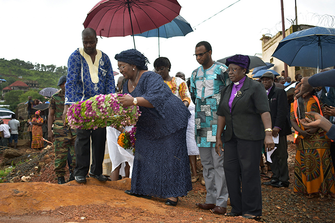 Sierra Leone's First Lady, Sia Nyama Koroma, lays the first wreath at the site of the landslide after a worship service held in memory of the dead those who died in the landslide and flooding two weeks ago. Many of the bodies were never recovered. Photo by Phileas Jusu, UMNS.