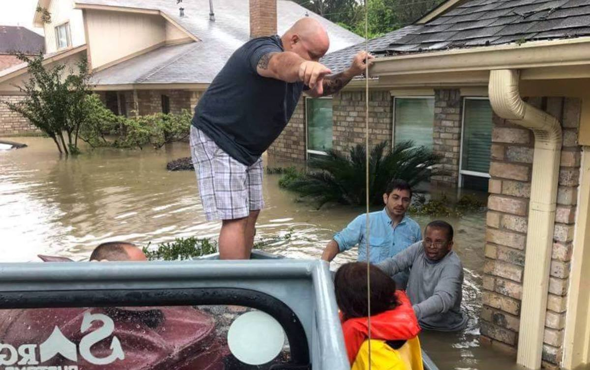 Volunteers from Houston's Bear Creek United Methodist Church used boats to help residents evacuate from Tropical Storm Harvey's rising floodwaters. Photo by Michele Sibley, courtesy Bear Creek United Methodist Church.