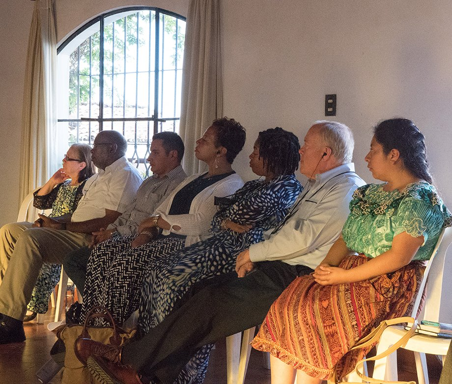 United Methodist bishops and members of the Evangelica Nacional Metodista Primitiva de Guatemala church listen to an overview of Guatemala and Methodism at Santo Tomas Hotel in Chichicastenango, Guatemala.
