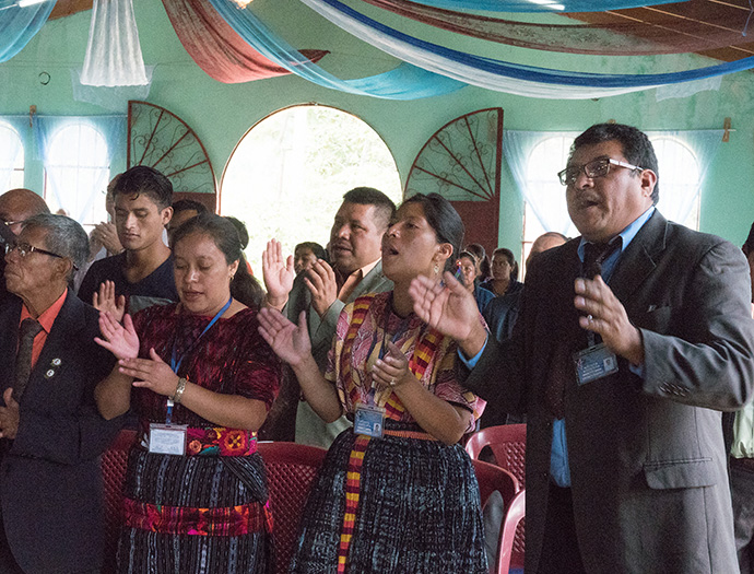 Members of Iglesia Nacional Methodista Primitiva Fuente De Vida and local pastors from the area sing during worship service.