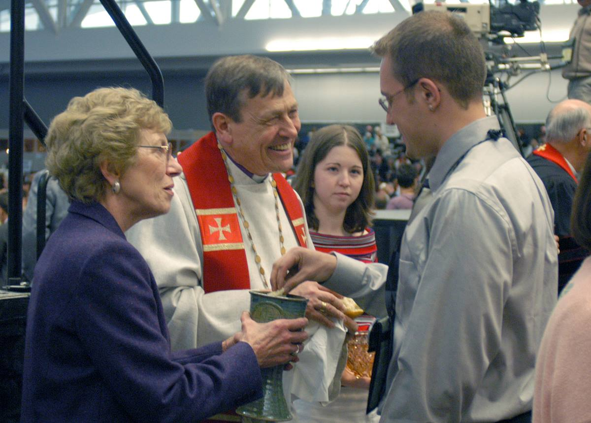 United Methodist Bishop Ruediger R. Minor (center) serves communion during the opening worship of the United Methodist Church's 2004 General Conference in Pittsburgh. Photo by John C. Goodwin, UMNS.