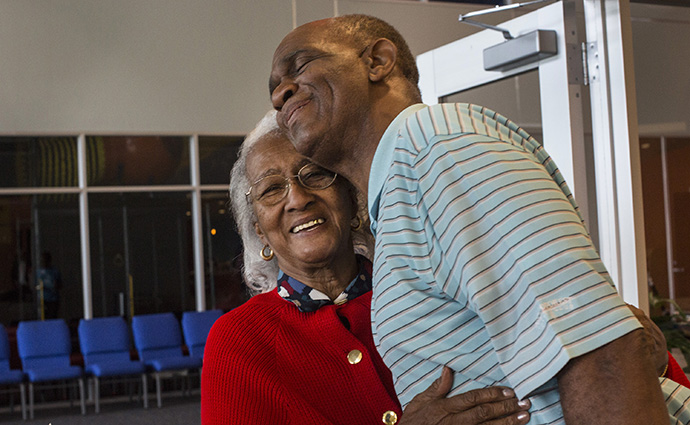 The Rev. Kirbyjon Caldwell greets volunteer Mary Jackson at the doorway of the food and clothing distribution center at Windsor Village United Methodist Church in Houston. Photo by Kathleen Barry, UMNS