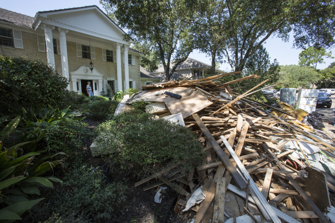 Debris piles up in front of a home affected by flooding from Hurricane Harvey in Houston.  Photo by Kathleen Barry, UMNS