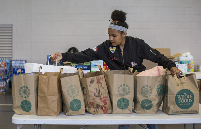 Zamora Contreras, age 13, helps sort items for folks in need following flooding from Hurricane Harvey. She's a member of Westbury United Methodist Church in Houston, and the church's gym has become a distribution center for donated items.  Photo by Kathleen Barry, UMNS.