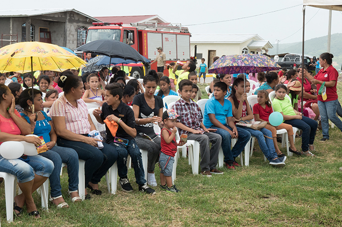 The congregation gathered for the laying of the cornerstone for Casa de Paz United Methodist Church in San Pedro Sula, Honduras. The church has had many challenges to overcome on their journey to build a church. Currently they are meeting in a building that is a former bar. Photo by Kathy L. Gilbert, UMNS.