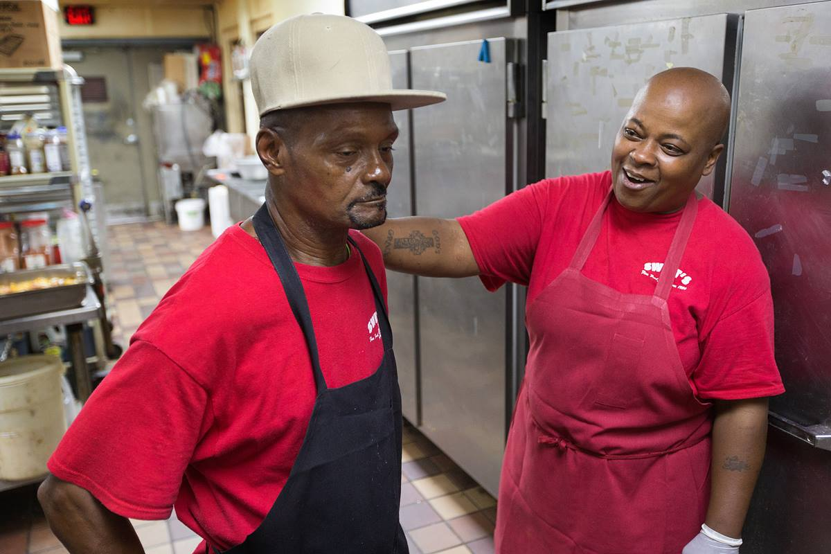"Debra Kelley, right, enjoys a moment with Johnny Woods during their morning shift at Swett's, a Nashville southern home-style restaurant. Both Kelley and Woods are ex-offenders. ""Mr. Swett believes in second chances,"" Kelley says. Photo by Mike DuBose, UMNS."