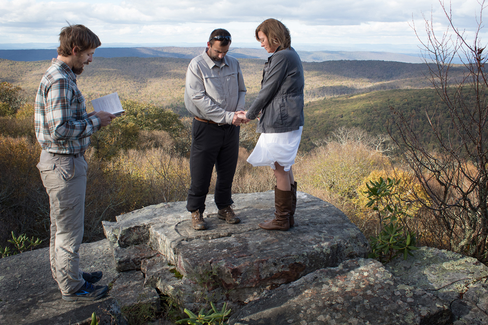 The Rev. Matt Hall conducts a renewal of wedding vows service for Nick and Stephanie Houle atop Sugar Run Mountain, just off the Appalachian Trail near Pearisburg, Va. Hall serves as a United Methodist chaplain appointed to the trail community.
