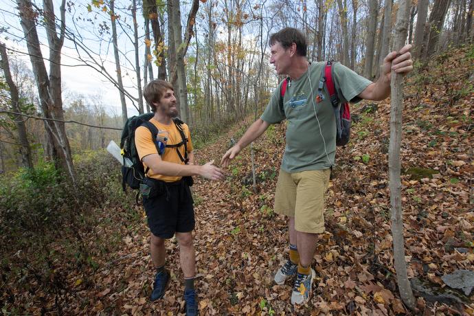 The Rev. Matt Hall (left) visits with hiker Patrick Dolin on the Appalachian Trail near Pearisburg, Va.