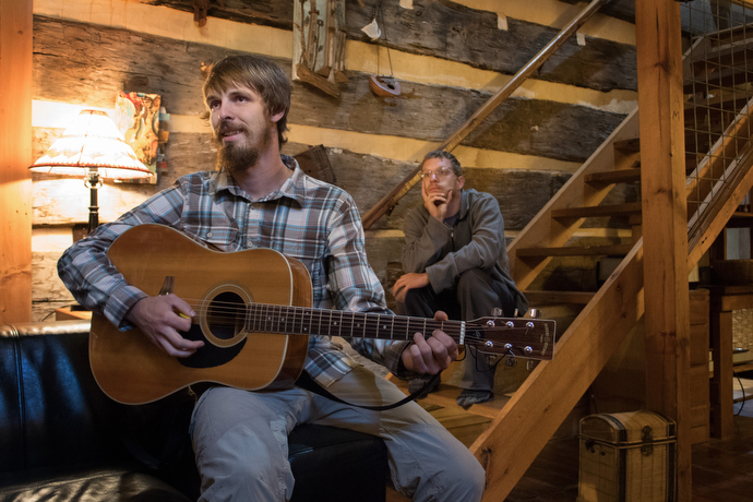 The Rev. Matt Hall plays guitar at the Woods Hole Hostel, a popular rest stop for hikers just off the Appalachian Trail near Pearisburg, Va.