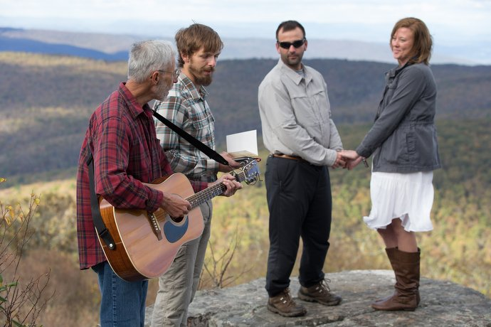 Nick and Stephanie Houle renew their wedding vows atop Sugar Run Mountain, just off the Appalachian Trail near Pearisburg, Va. Officiating are United Methodist pastors Alan Ashworth (left) and Matt Hall. Ashworth leads two churches in nearby Bland County, Va., and helped found the Appalachian Trail Outreach Ministry.