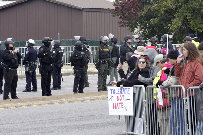 In Shelbyville, Tenn., law enforcement kept the white nationalists and counterprotesters cordoned off into separate sections across a four-lane road. To enter either side, people had to go through two checkpoints where law enforcement swiped them with metal detectors. Photo by Kathy L. Gilbert, UMNS.