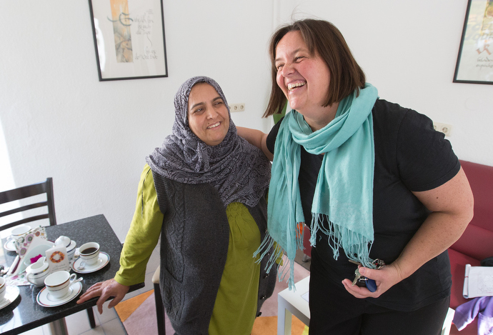 The Rev. Heike Miller (right) introduces Sahize, a recent immigrant from Syria, at Cafe Gegenueber, a weekly gathering for coffee, cake and conversation at the United Methodist Church in Lorsbach, Germany. Photo by Mike DuBose, UMNS.