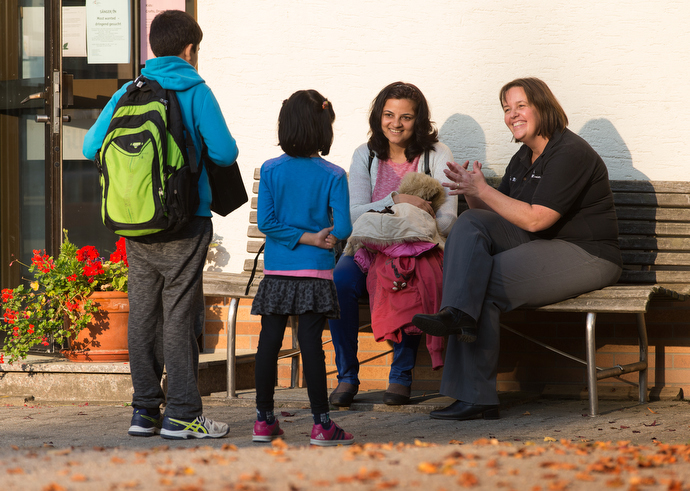 The Rev. Heike Miller (right) visits with Ruchi Shukla and her children Mohit (left) and Kayna outside the United Methodist Church of the Caller in Frankfurt, Germany. The family, recently arrived from India, was attending a German class offered by the church. Photo by Mike DuBose, UMNS.