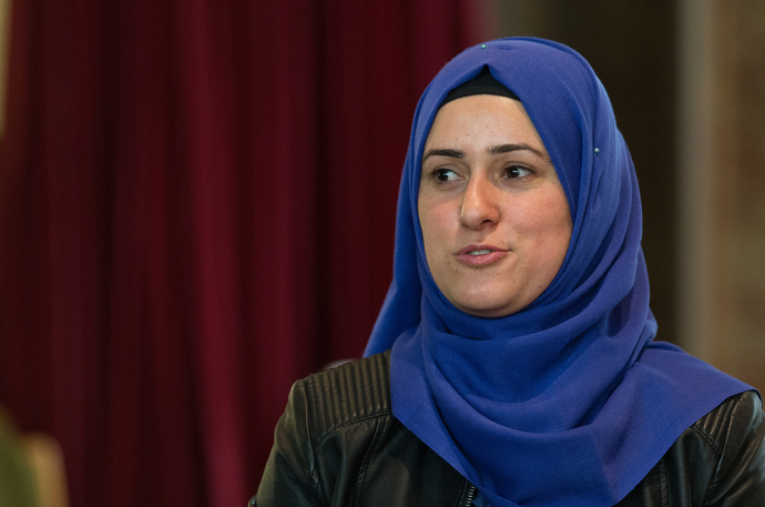 """A Kurdish Syrian woman in the beginning German class at the United Methodist Church of the Redeemer in Bremen, Germany, talks about how little contact she has with Germans. """"It's lonely,"""" said the woman, who is a Muslim. Photo by Mike DuBose, UMNS."""