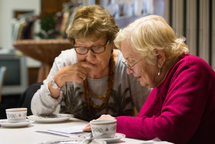 Retired teacher Doris Franke (left) tutors Russian immigrant Elmira Rieb during Café Tiramisu at the United Methodist Church of the Redeemer in Bremen, Germany. The weekly program gathers volunteers who teach German, help with translations of letters from the German government or simply talk with immigrants. Photo by Mike DuBose, UMNS.