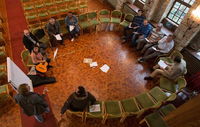 The Rev. Susanne Nießner-Brose (at white board) leads a German class for recent immigrants at the United Methodist Church of the Redeemer in Bremen, Germany. Photo by Mike DuBose.