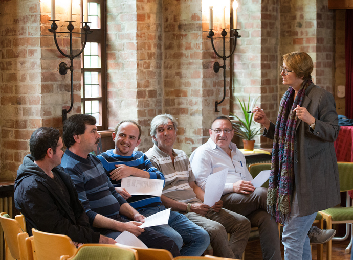The Rev. Susanne Nießner-Brose (right) leads a German class for recent immigrants at the United Methodist Church of the Redeemer in Bremen, Germany. Photo by Mike DuBose, UMNS.