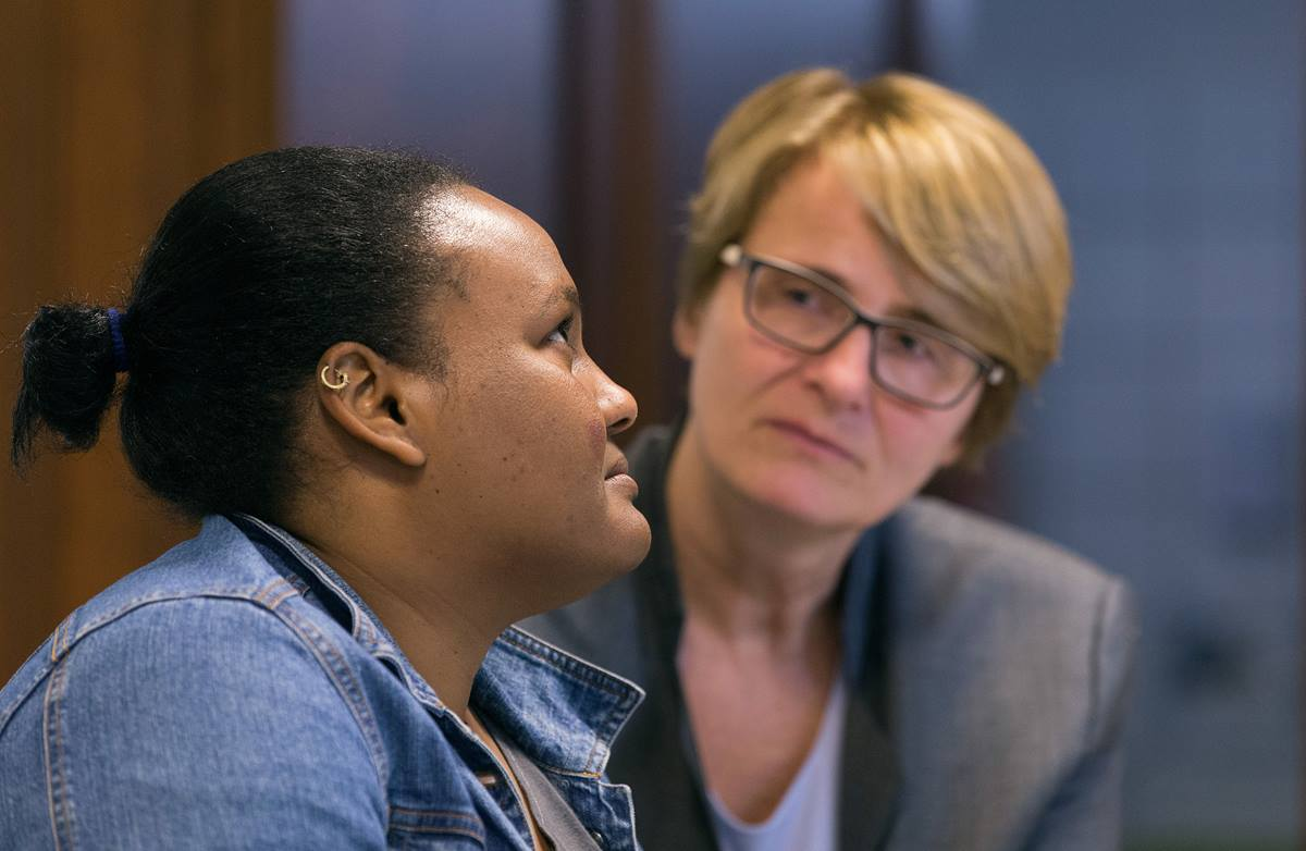 The Rev. Susanne Nießner-Brose (right) listens while a 27-year-old Sudanese woman who asked that she be called Fatima relates her story of fleeing Sudan to seek religious freedom in Europe. She  is taking asylum at the United Methodist Church of the Redeemer in Bremen, Germany, where Nießner-Brose is pastor. Photo by Mike DuBose, UMNS.