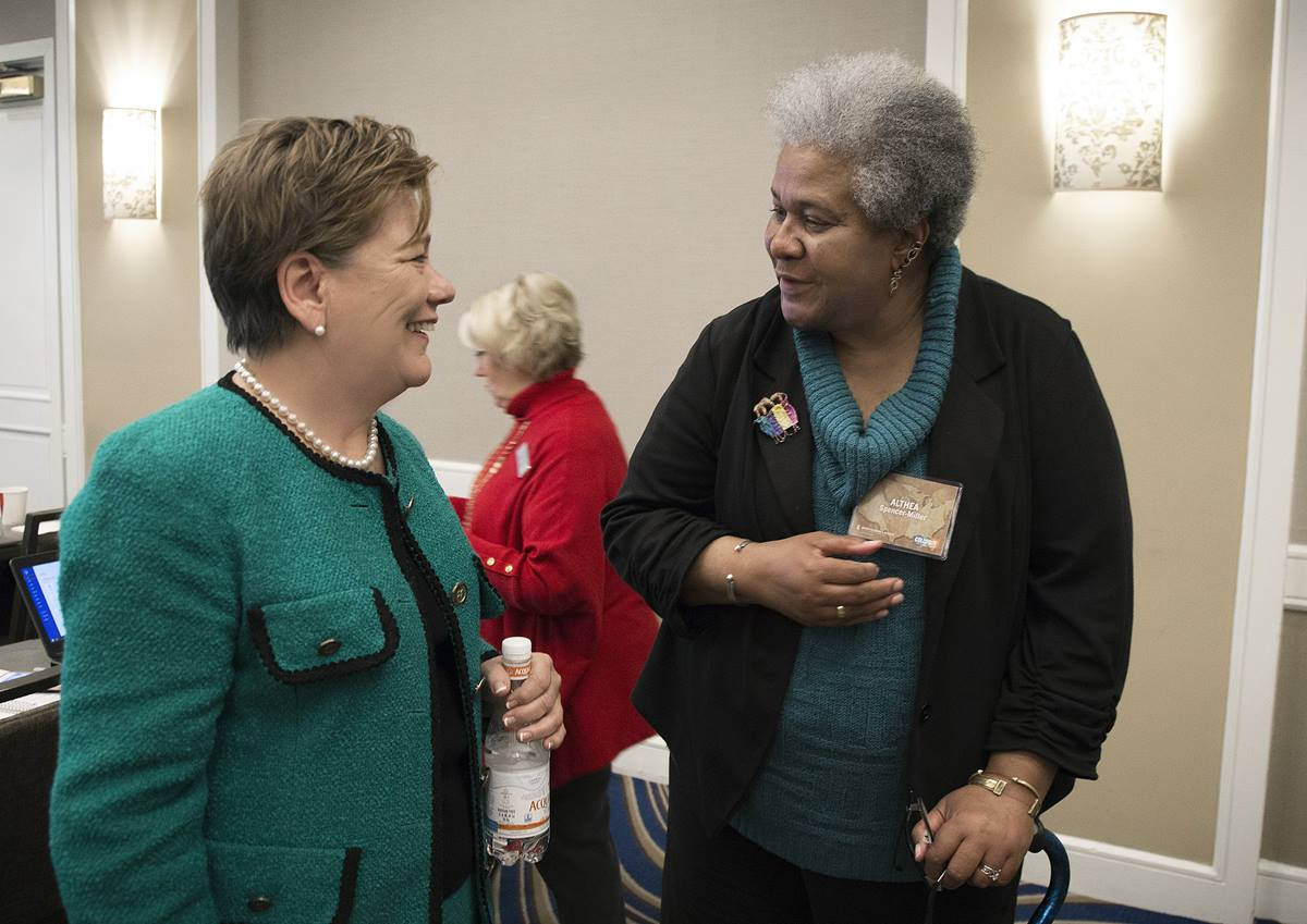 The Rev. Kim Cape (left), top executive of the United Methodist Board of Higher Education and ministry, chats with Althea Spencer-Miller, of Drew University Theological School, during a break at a Nov. 12-15 colloquy in Boston. The event brought together United Methodist scholars and bishops to consider God's mission for the denomination.