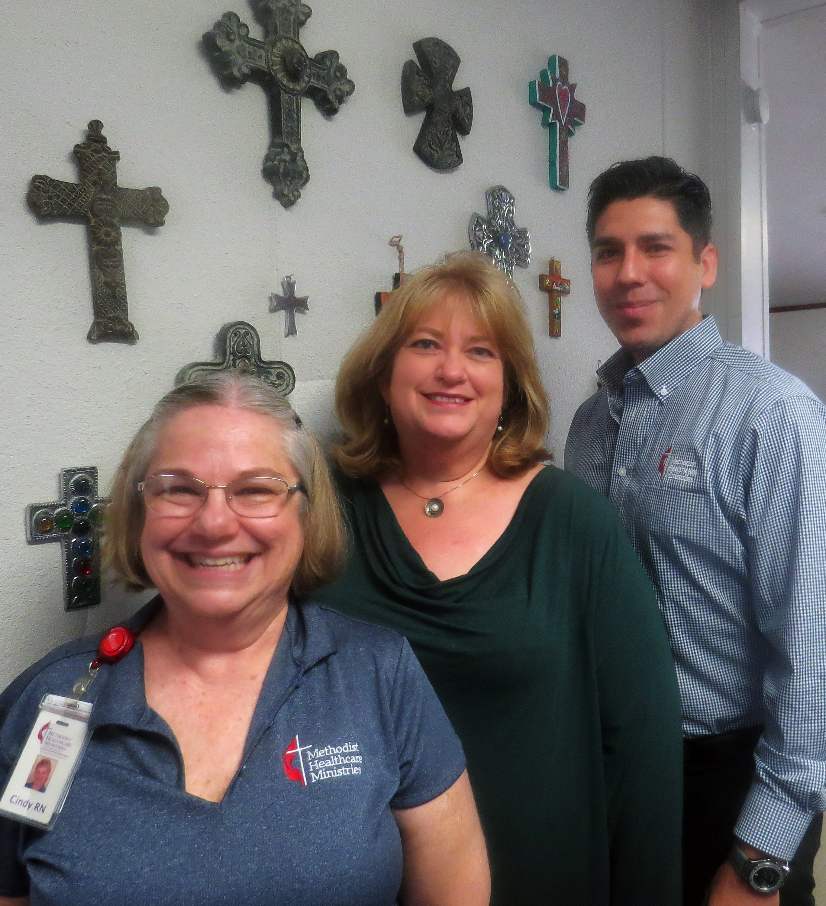 Cindy Bishop (left) stands with the Rev. Michelle Vernone and Robert Chapa. Vernone is pastor of First United Methodist Church in Edinburg, Texas. Bishop and Chapa are based there and work for Methodist Healthcare Ministries of South Texas. Bishop is a Wesley Nurse, doing public health outreach, and Chapa is a counselor. Photo by Sam Hodges, UMNS.