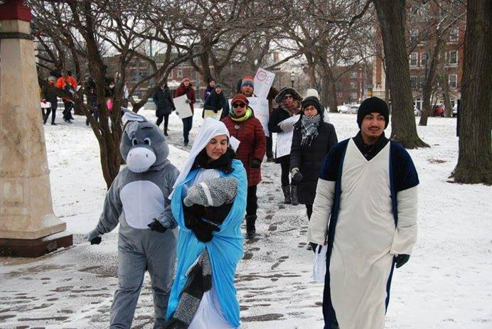 Members of Humboldt Park United Methodist Church in Chicago joined in an ecumenical Las Posadas procession. The re-enactment of Mary and Joseph's search for safe lodging carries special resonance for at least one family at the church. Photo courtesy of the Rev. Paula Cripps-Vallejo.