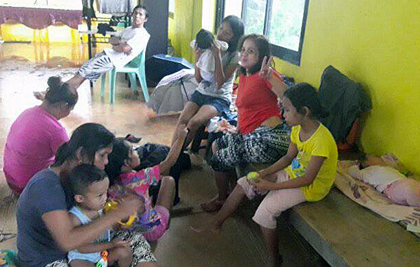 Women and children take sanctuary inside the Light and Life United Methodist Church in Tacloban City, Philippines, after Typhoon Urduja, also known as Kai-Tak, struck the area on Dec. 16. Three persons reportedly died and thousands of families were driven from their homes by floods and landslides. Photo courtesy of Iris Picardal-Terana and Ronnel Tuscano de Juan, Light and Life United Methodist Church.