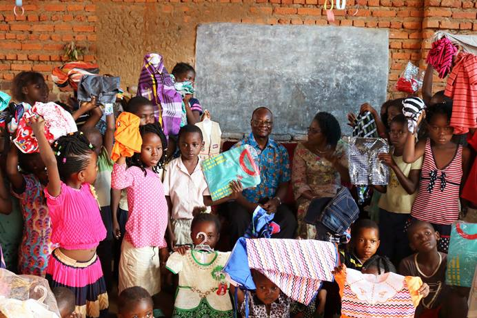 Orphans are being sheltered in a church orphanage in Kindu or with host families after rebel violence in the Democratic Republic of Congo displaced residents there. Seated (center, in blue shirt) is East Congo Area Bishop Gabriel Yemba Unda, along with his wife, Marie Claire Unda (to his right), who has been gathering the orphans for Bible study and meals twice a week.