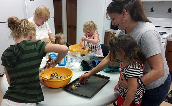 Christine Zimmerman, far right, joins with families from First United Methodist Church in Greensburg, Pa., to bake cookies for a nearby homeless shelter. Members of the church's mission team still speak of how the Zimmermans helped ignite the church's outreach to the community. Photo courtesy of the Zimmermans.