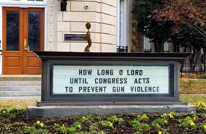 The sign at the United Methodist Building in Washington, where the Board of Church and Society's offices are, was changed after the mass shooting at a Parkland, Fla., high school. Photo courtesy of United Methodist Board of Church and Society.