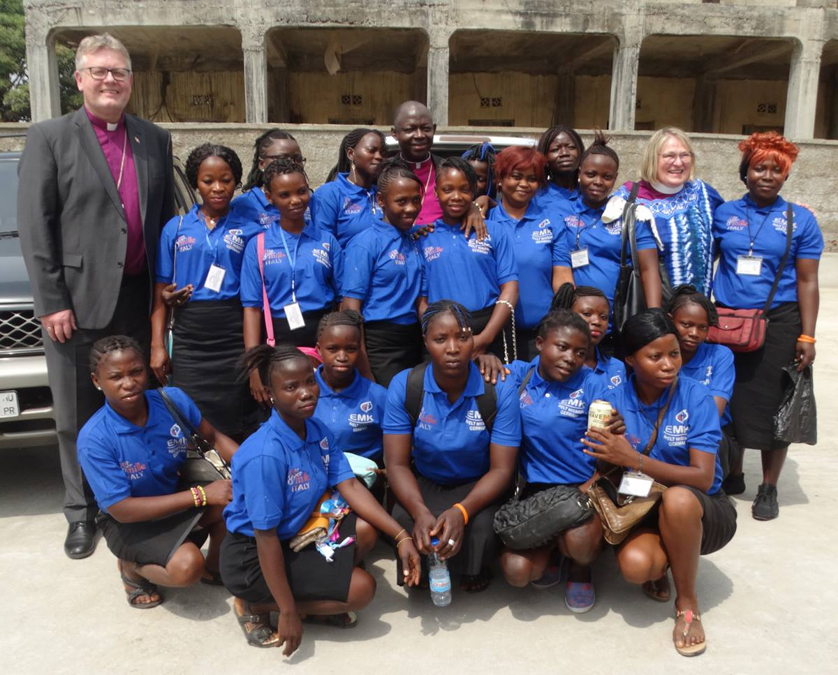 Bishop Christian Alsted (far left), Bishop John Yambasu (center back) and Bishop Rosemarie Wenner (far right) join trainees at the dedication of the new United Methodist Women's Training Center in Bo, southern Sierra Leone. Photo by Phileas Jusus, UMNS.