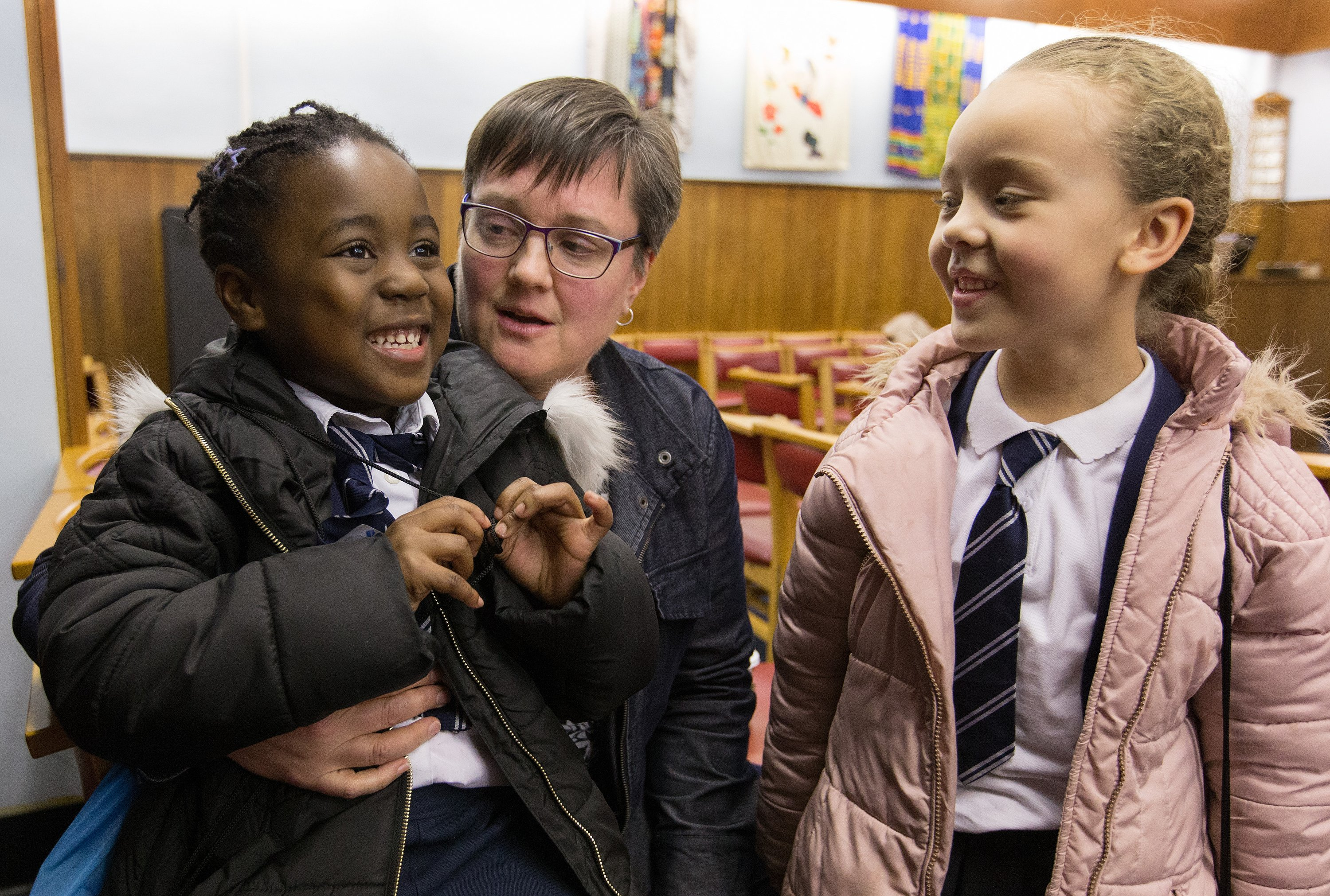 Nwarebea Baffoe (left) and Rebecca Henry, both age 6, stop by after school to visit with the Rev. Janet Corlett at Bermondsey Central Hall Methodist Church in London. Photo by Mike DuBose, UMNS.