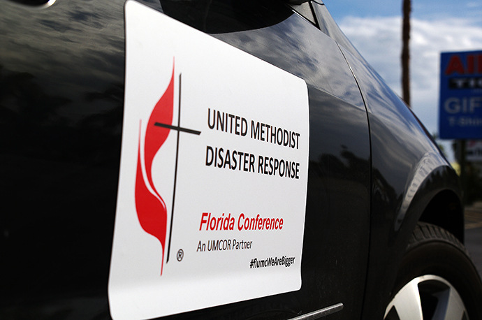A Florida Conference vehicle displays a magnetic sign identifying it as a disaster response unit. Photo by Gustavo Vasquez, UMNS.