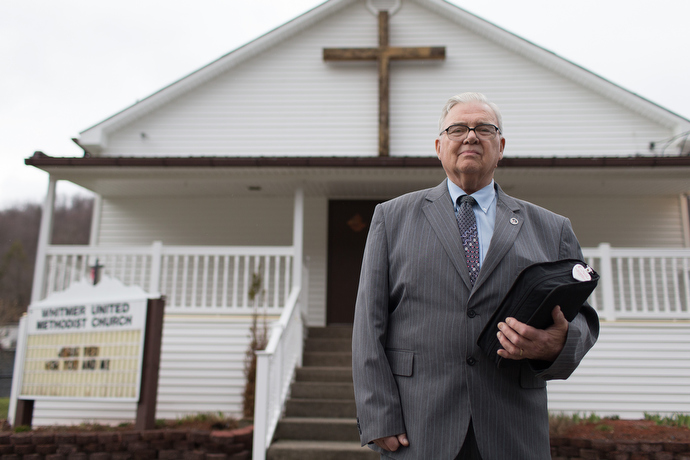 The Rev. Earl Bible stands outside Whitmer United Methodist Church in Seneca Rocks, W.Va., in 2015. File photo by Mike DuBose, UMNS.