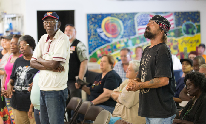 Earl Wollitt (right, foreground) casts his eyes upward during worship at Seashore Mission United Methodist Church in Biloxi, Miss., in 2015. File photo by Mike DuBose, UMNS.