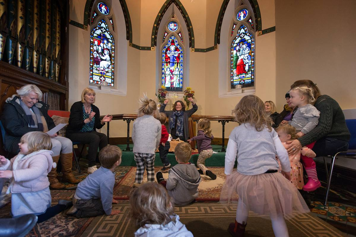 """The Rev. Katy Thomas (rear) presides over a """"Tiddly Nativity"""" activity for young children at St. Mary's Methodist Church in Handforth, England. The church is one of three Thomas serves in the Greater Manchester area. Photo by Mike DuBose, UMNS."""