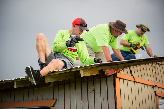 Members of a volunteer team from the South Carolina Conference install a new metal roof on a hurricane-damaged roof in Hatillo. From left are: Nate Gibson, the Rev. Mike Evans and Matt Brodie. The team of ten spent eight days in northern Puerto Rico, which was devastated last fall by back-to-back hurricanes. Photo by Jessica Brodie.