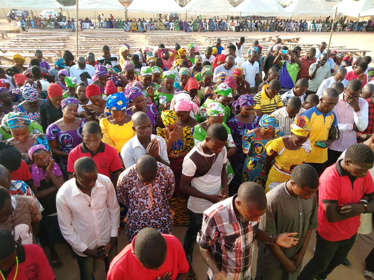 Members of the Southern Nigeria Conference pray during the 2018 Christian Revival Gathering held March 14-18 in Jalingo, Nigeria. More than 12,000 members attended, including a group who had left the conference five years ago. Photo by Ande I. Emmanuel, UMNS.