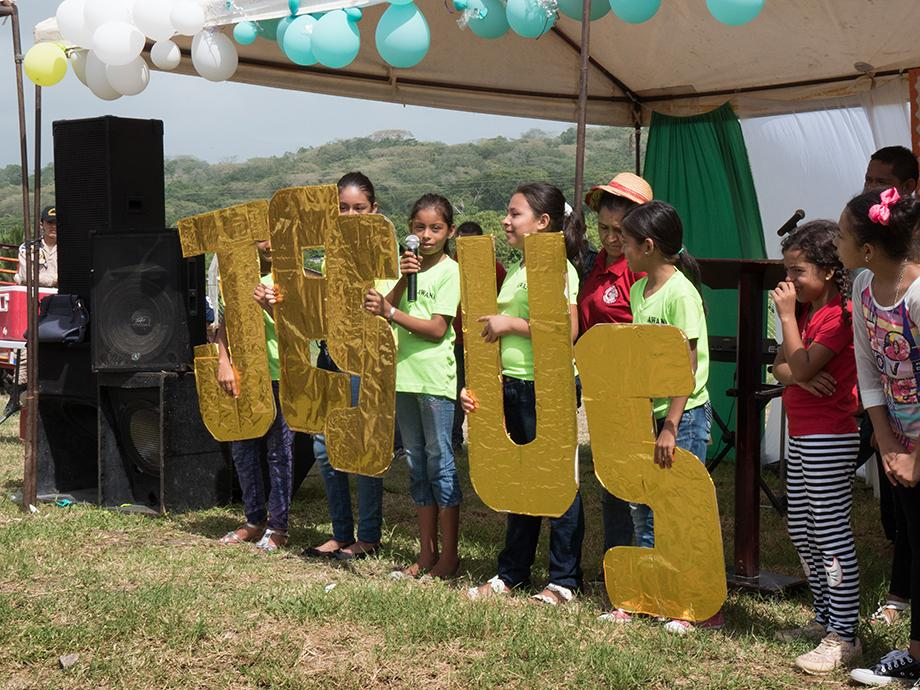 Children sang and read scripture behind large letters spelling out Jesus as part of the celebration of placing the cornerstone for Casa de Paz United Methodist Church. Photo by Kathy L. Gilbert, UMNS