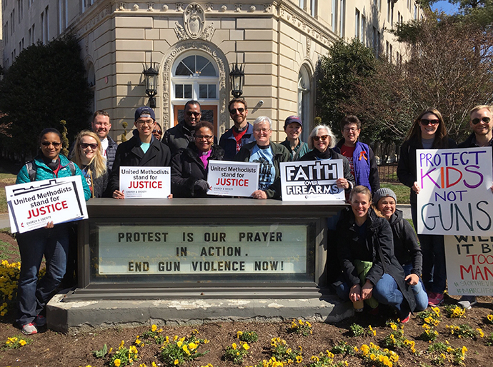 Bishop LaTrelle Easterling, the episcopal leader of the Baltimore-Washington Conference (center), along with other members from Foundry United Methodist Church in Washington, stand in front of the United Methodist Building before the rally. Photo by Sheila George.