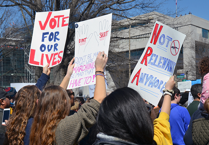 Signs at the March for Our Lives in Washington March 24 send the message that gun laws need to be changed so that people are safe. United Methodists and other faith leaders lent their voices and feet to the cause. Photo by Erik Alsgaard.