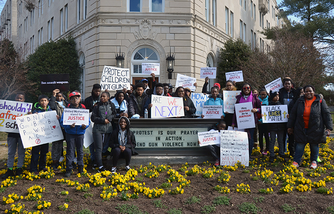 Youth from the Greater Washington District of the Baltimore-Washington Conference, pose outside the United Methodist Building in Washington March 24, before participating in the Walk for Our Lives. Photo by Erik Alsgaard.