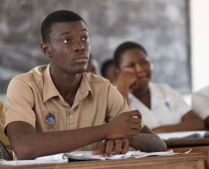 Students listen to their teacher at the United Methodist Koumassi School in Abidjan. Photo by Mike DuBose, UMNS.