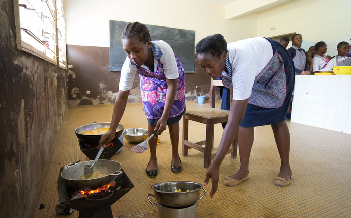 Michelle Ade Eba (left) and Grace Sossonan fry potatoes in a home economics class at the United Methodist Anyama School in Abidjan. Photo by Mike DuBose, UMNS.